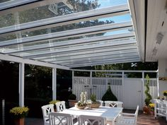 Be protected from the rain with a Reynaers at Home veranda