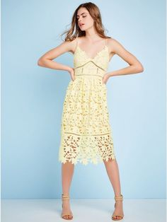 93e965480a Lace overlay lends timeless appeal to this sleeveless dress
