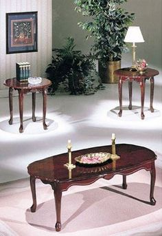 The #Essex Cherry 3-Piece Coffee and End Table Set has beautifully crafted curved legs and Carved aprons with palmetto details to highlight rich dark cherry fini...