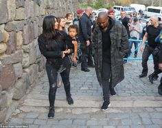 Famous the world over: The family were followed by a crowed of fans as they checked out th...