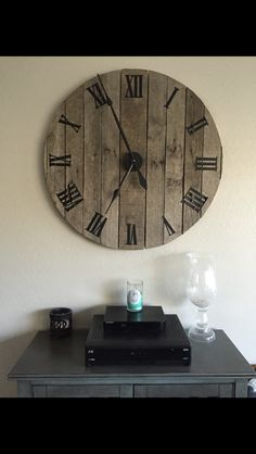 Here's a clock we made out of old oak pallet board we found. Super easy to made and looks great with just about an style/ theme you've got goin' on in your house.... Cut the pallet wood to shape, give it some support with running a few small vertical beams in back, add a clock/ Roman numerals (we bought ours off of amazon) and whala - you've got a beautiful custom clock that you are guaranteed to get complemented on every time you have company over :)