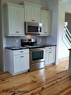 Knotty Pine Floors And Beautiful Creamy White Cabinets