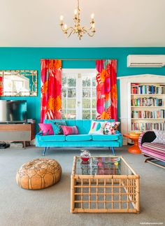 """For the living room walls, homeowner Lou chose Resene Seeker, a vibrant green-blue, """"just because I love it,"""" she says"""