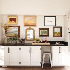 CeciJ interiors - hang art on the backsplash. Use mirrors or glass covered, framed art over sink/range