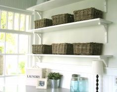 laundry room shelves with baskets to hide all the junk!
