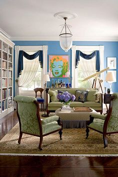Bright Prussian blue walls and a multihued Warhol perk up the library in this Greek Revival home. - Traditional Home ® / Photo: John Bessler / Design: Jamie Drake Traditional House, Traditional Design, Traditional Decorating, Beautiful Interiors, Beautiful Homes, Traditional Home Magazine, Greek Revival Home, Living Room Colors, Living Rooms