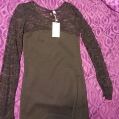 Slim fitting short black dress w/lace sleeves Brand new and never worn and in excellent condition Toona BaBa Dresses