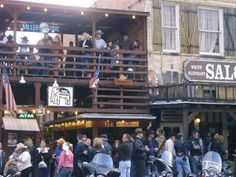 Relive the western experience at the Fort Worth Stockyards by witnessing a real cattle drive, visiting authentic saloons, the world's largest honky-tonk, or dining on Texas-style cuisine. Fort Worth Stockyards, Cattle Drive, Honky Tonk, Old West, Pregnancy Photos, Street View, Balcony, Shower Ideas, Photo Shoot