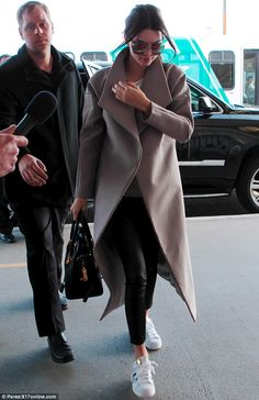 Jetting off: Kendall Jenner was seen at LAX airport on Saturday morning, after her father ...