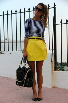 Shop this look for $97: http://lookastic.com/women/looks/longsleeve-shirt-and-mini-skirt-and-ballerina-shoes-and-tote-bag-and-belt-and-sunglasses/2901 — White and Navy Horizontal Striped Longsleeve Shirt — Yellow Mini Skirt — Black Leather Ballerina Shoes — Black Leather Tote Bag — Black Leather Belt — Black Sunglasses