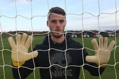 Safe hands: @manutd goalkeeper David De Gea takes part in a photo shoot at the Aon Training Complex.