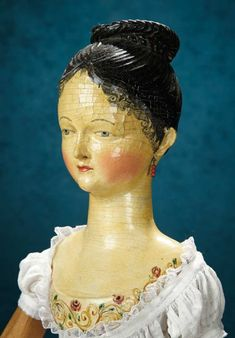 Carved Wooden Grodnertal Doll with Decorated Yoke and Rare Carved Chignon 8000/11,000 | Sold for 17,000. 39inches