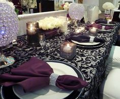 silver and black damask over lay paired with Aubergine napkins and crystal centerpieces- so classy