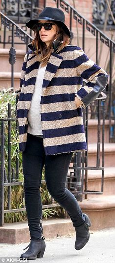 Fashion star: Olivia looked fantastic as she headed out to lunch, wearing a striped navy and tan coat over a simple bump highlighting white ...