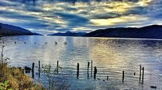 Loch Ness, Scotland at dusk. Beautiful! Yes. I love this country and its people. My great grandfather was born there as well.