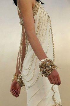 Mix pearl bracelets with chunky chain bracelets, beaded bracelets or studded warp bracelets