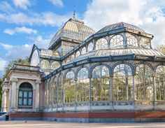The Crystal Palace in Madrid, Spain, as it normally appears. Built in 1887 as a conservatory to house exotic flora and fauna, it is now used to display art exhibits. Crystal Palace Madrid, Castle Window, Conservatory Garden, Glass Structure, Le Palais, Destination Voyage, Destinations, Architecture Details, Beautiful Architecture