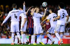 Lionel Messi of FC Barcelona argues with Luka Modric of Real Madrid CF during the Copa del Rey Final between Real Madrid and FC Barcelona at Estadio...