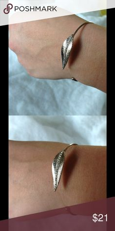 Delicate CZ Feather Bracelet Beautiful delicate silver bracelet, with etched feather & CZ,S Lovely on it own, or layer it with other delicate pieces! Very on trend look! Farah Jewelry Jewelry Bracelets
