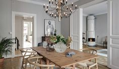 The FLOS 2097 pendant light adds modern sophistication to this spacious dining room with wood seating and a wood table. Kitchen Interior, Interior Design Living Room, Living Room Decor, Interior Decorating, Dining Room, Piece A Vivre, Wood Table, Home Furniture, Table Furniture