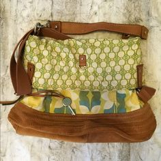 """✨HP✨Fossil Floral Crossbody Tote Fossil floral Key-per convertible tote from a couple summers ago. Preloved with minor signs of wear to the suede bottom and a few marks inside. 8/10 condition. Long crossbody strap or short leather shoulder strap. No dust bag. No trades or outside transactions. Please make an offer. Still considering keeping this one. Host Pick """"Weekend Chic"""" 4/12/15. Fossil Bags Totes"""