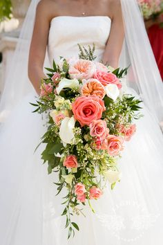 pink bridal bouquets Gorgeous cascade of blush pink roses and peonies combined with ivory white calla lilies. Lush emerald greenery adds a gentle cascading effect to this bridal bo Cascading Wedding Bouquets, Bridal Bouquet Pink, Bride Bouquets, Flower Bouquet Wedding, Flower Bouquets, Coral Peony Bouquet, Lily Bouquet, Cascade Bouquet, Bridal Gown