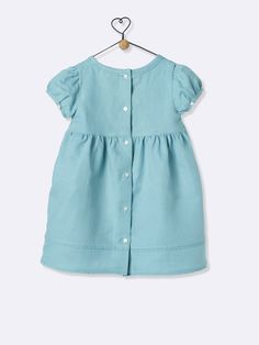 A gingham check is highlighted with silver thread or in a plain linen, this dress adds chic stylinhg for beautiful summer days. Details Narrow lace