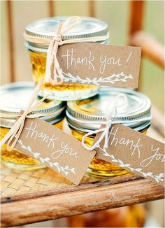 Load up on little glass jars from any bulk store or superstore and then fill them with your favorite jam, jelly or honey! Accent with thank you tags and a ribbon or twine for that extra amount of cuteness. PC: Danielle Woodall Photography