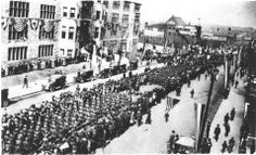World War I homecoming parade moving east down Broadway, in front of Hume Fogg High School. - 1919  Nashville, Tn