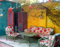 Fanciful, fabric on seating, wall colors, room divider, hanging ornaments and vines! Oh la la - Model Home Interior Design Mexican Patio, Mexican Garden, Mexican Courtyard, Mexican Hacienda, Outdoor Rooms, Outdoor Living, Outdoor Decor, Outdoor Kitchens, Outdoor Fun