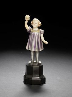 Ferdinand Preiss 'The Posy' a cold-painted bronze and carved ivory figure of a Young Girl, circa 1925