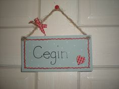 Sign with Welsh wording for Kitchen, a gift bought for me a few years ago.