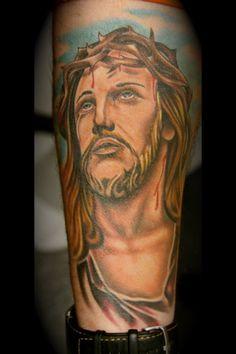 Jesus tat on forearm