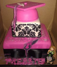 Pink graduation cake with damask pattern. Pink graduation cake cap. Color guard themed graduation cake.