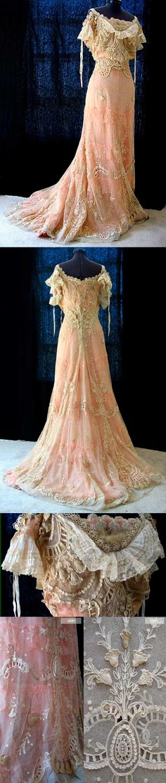 Dress, early 1900s. Ecru net that is intricately embroidered with floral and leaf motifs in the tambour style.