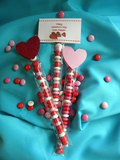 Sweet Valentine Party Favors...red, pink & white m candies stuffed into a cellophane bag and topped off with a glittered paper heart stapled to the top.
