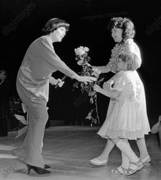 Spectators giving flowers to French singer Mireille Mathieu (left) as she performed in Moscow