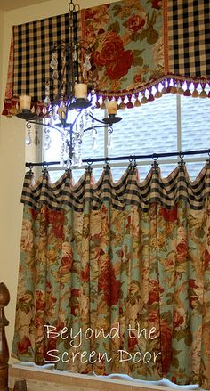 Love the turquoise/red rose material on the café curtains.  Nice box pleat valance.