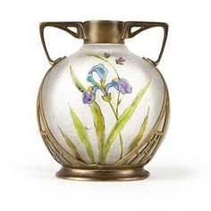 A German Art Nouveau Cast Brass-mounted Art Glass Vase, Carl Deffner. Circa 1900, Esslingen,  the pierced, dual-handled brass mount enclosing a clear frosted art glass vase with cut-back and polychrome enameled floral sprays to each face, over a spreading oval foot.