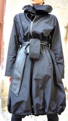 Fashion Black Extravagant Large Hooded Raincoat/ Trench Coat /Maxi Zippers Blazer With side pockets and Eco Leather Belt ! Maxi Zipper in front Elastic stoppers at the bottom and on collar makes it extravagant and chic and edgy and really Fun to wear .....That will be your FAVORITE ONE ... Be