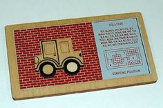 The Sliding Bubble Car Puzzle -- designed by Serhiy and Peter Grabarchuk in 1996; published in Serhiy's book in   1996. Then, the puzzle was made by GRIFFIOEN Design BV (The Netherlands) of plywood using a laser-cut technology, 1996.