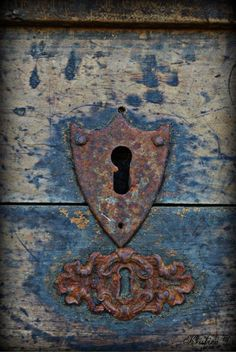 Rusted key plate in the shape of a shield