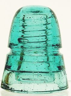 """""""Beehive"""" style telegraph insulator, marked: K / H. // PETTICOAT, made by Hemingray Glass Company, circa in aqua. Antique Bottles, Old Bottles, Antique Glass, Glass Bottles, What Is Glass, Antique Shelves, Glass Insulators, Insulator Lights, Vintage Telephone"""
