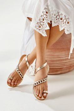 Classic with a twist Eve Women's flat sandals featuring our signature chain strap with a plain toe ring and ankle wrap. Whether on vacation or in the city, they will complement any outfit in your summer wardrobe. These elegant sandals are the type you can wear instead of heels without feeling under-dressed. Handmade in Athens, Greece of the best quality leather the classy flats come in gold, silver with gold details, black, camel, blue with gold, white with silver. Find your perfect pair!