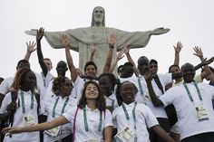 Members of the Refugee Olympic Team pose together in front of the Christ the Redeemer statue on July 30, 2016.  The Atlantic