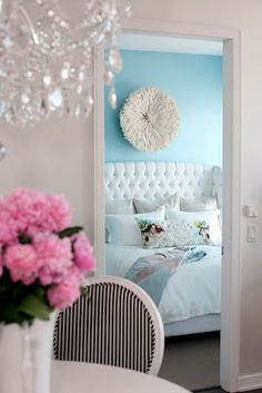 love this image of a bedroom seen from another room!  The pink, blue and white just compliment each other.
