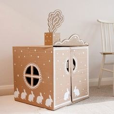 Let them decorate their own cardboard playhouses with fabric, paper or paint.
