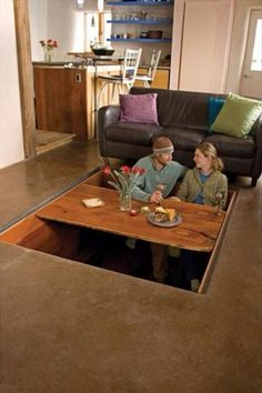 What even is the point of this??!! table in the floor that disappears when not in use. Ridiculous