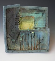 Rustic hand-built decorative platter in dusty blue, turquoise and yellow