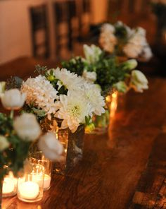 "Table arrangements for your wedding that include dahlias. Create an ""urban barn"" feel by topping farm tables by accenting groupings of dahlias with ranunculus, hyacinths, seeded eucalyptus, and stars of Bethlehem."